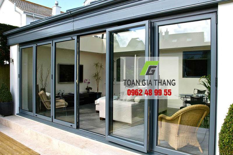 anthracite-grey-bi-fold-doors-with-a-traffic-door
